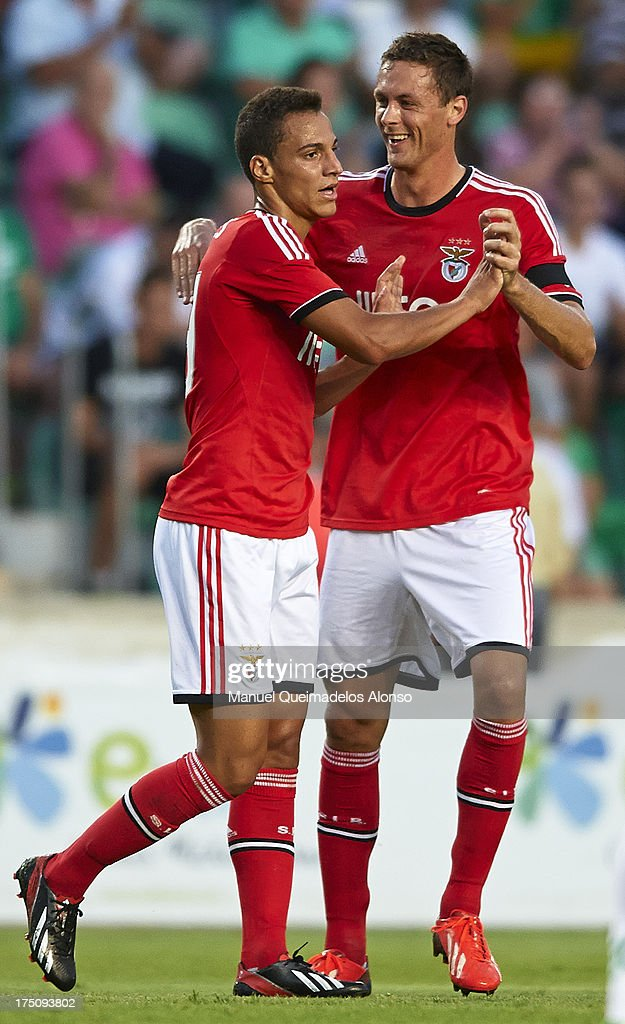 Rodrigo (L) of Benfica celebrates with his teammate Matic during a friendly match between Elche CF and Benfica at Estadio Martinez Valero on July 31, 2013 in Elche, Spain.