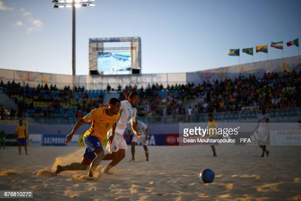 Rodrigo of Brazil battles for the ball with Masayuki Komaki of Japan during the FIFA Beach Soccer World Cup Bahamas 2017 group D match between...