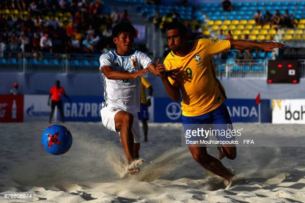 Rodrigo of Brazil battles for the ball with Shotaro Haraguchi of Japan during the FIFA Beach Soccer World Cup Bahamas 2017 group D match between...
