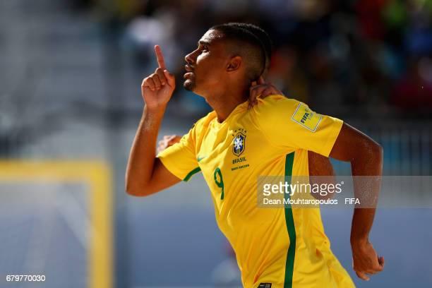 Rodrigo of Brazil celebrates scoring a goal with team mate Lucao during the FIFA Beach Soccer World Cup Bahamas 2017 semi final match between Brazil...