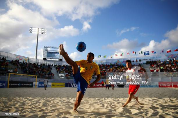 Rodrigo of Brazil controls the ball in front of Witold Ziober of Poland during the FIFA Beach Soccer World Cup Bahamas 2017 group D match between...