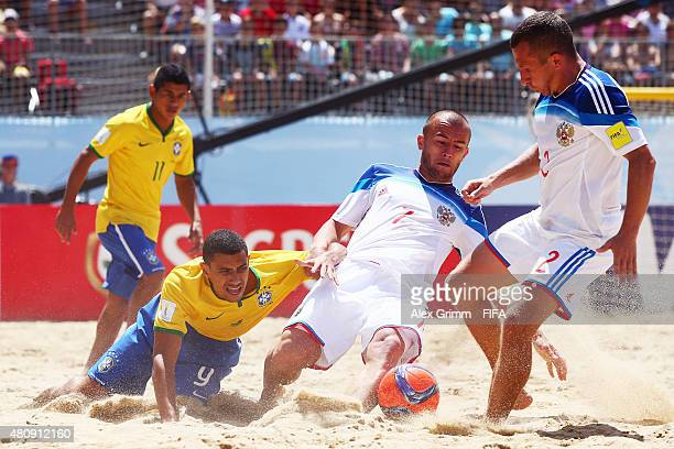Rodrigo of Brazil is challenged by Anton Shkarin and Yury Gorchinskiy of Russia during the FIFA Beach Soccer World Cup Portugal 2015 Quarterfinal...