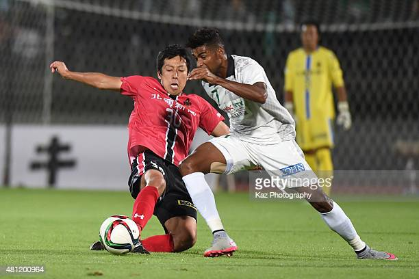 Rodrigo of FC Gifu beats Masaru Akiba of Zweigen Kanazawa during the JLeague second division match between Zweigen Kanazawa and FC Gifu at Ishikawa...