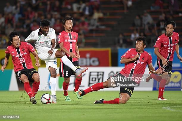 Rodrigo of FC Gifu shoots the ball under the challenge from Yuji Sakuda of Zweigen Kanazawa during the JLeague second division match between Zweigen...