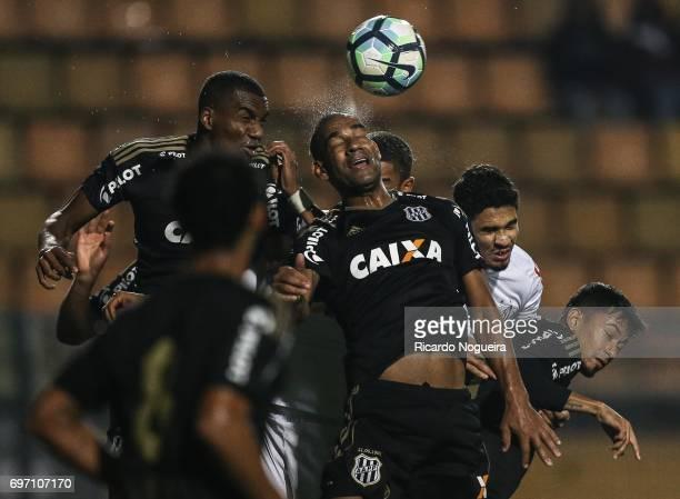 Rodrigo of Ponte Preta wins a header during the match between Santos and Ponte Preta as a part of Campeonato Brasileiro 2017 at Pacaembu Stadium on...