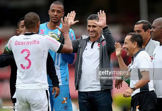 Rodrigo of Vasco celebrates scoring the second goal with his head coach Jorginho during the match between Sao Paulo and Vasco for the Brazilian...