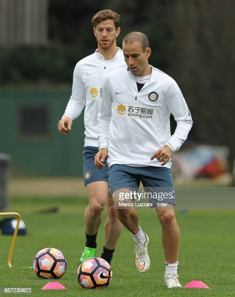 Rodrigo Palacio and Cristian Ansaldi of FC Internazionale Milano in action during the FC Internazionale training session at the club's training...