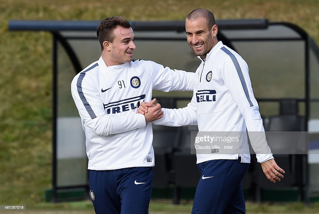 <a gi-track='captionPersonalityLinkClicked' href=/galleries/search?phrase=Rodrigo+Palacio&family=editorial&specificpeople=490993 ng-click='$event.stopPropagation()'>Rodrigo Palacio</a> (R) and <a gi-track='captionPersonalityLinkClicked' href=/galleries/search?phrase=Xherdan+Shaqiri&family=editorial&specificpeople=6923918 ng-click='$event.stopPropagation()'>Xherdan Shaqiri</a> during the FC Internazionale Training Session at Appiano Gentile on January 10, 2015 in Como, Italy.