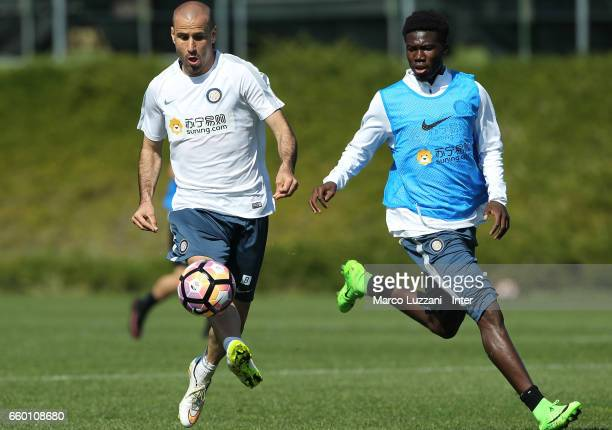 Rodrigo Palacio competes for the ball with Eloge Koffi Yao Guy during the FC Internazionale training session at the club's training ground Suning...