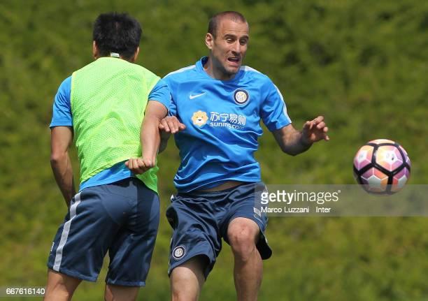 Rodrigo Palacio competes with Yuto Nagatomo during the FC Internazionale training session at the club's training ground Suning Training Center in...