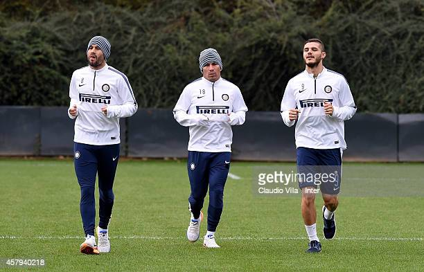 Rodrigo Palacio Gary Medel and Mauro Icardi during FC Internazionale Training Session at Appiano Gentile on October 27 2014 in Como Italy