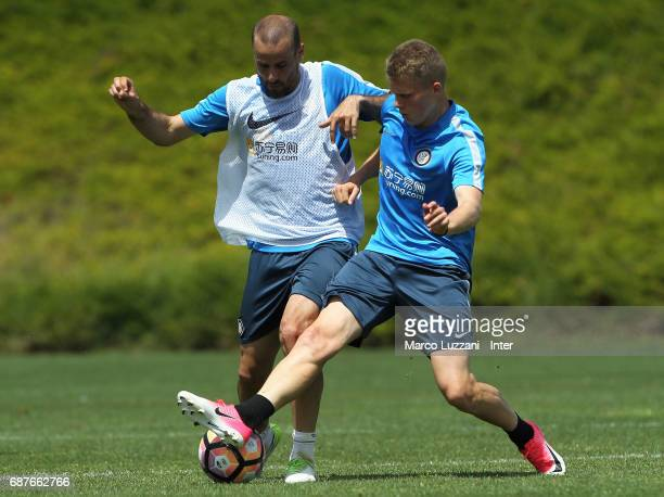 Rodrigo Palacio is challenged by Xian Ghislaine Emmers during the FC Internazionale training session at the club's training ground Suning Training...