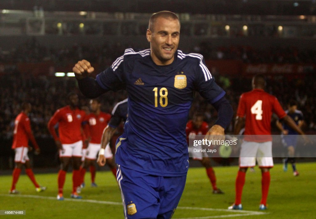 <a gi-track='captionPersonalityLinkClicked' href=/galleries/search?phrase=Rodrigo+Palacio&family=editorial&specificpeople=490993 ng-click='$event.stopPropagation()'>Rodrigo Palacio</a> of Argentina celebrates after scoring the opening goal during a FIFA friendly match between Argentina and Trinidad & Tobago at Monumental Antonio Vespucio Liberti Stadium on June 4, 2014 in Buenos Aires, Argentina.