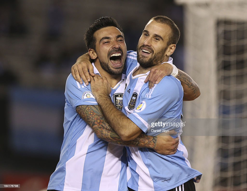 <a gi-track='captionPersonalityLinkClicked' href=/galleries/search?phrase=Rodrigo+Palacio&family=editorial&specificpeople=490993 ng-click='$event.stopPropagation()'>Rodrigo Palacio</a> of Argentina celebrates with teammate <a gi-track='captionPersonalityLinkClicked' href=/galleries/search?phrase=Ezequiel+Lavezzi&family=editorial&specificpeople=5451126 ng-click='$event.stopPropagation()'>Ezequiel Lavezzi</a> after scoring during a match between Argentina and Peru as part of the 17th round of the South American Qualifiers at Antonio Vespucio Liberti Stadium on October 11, 2013 in Buenos Aires, Argentina.