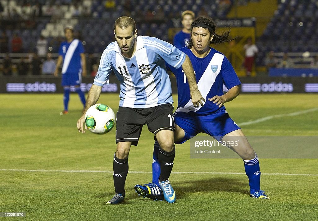 <a gi-track='captionPersonalityLinkClicked' href=/galleries/search?phrase=Rodrigo+Palacio&family=editorial&specificpeople=490993 ng-click='$event.stopPropagation()'>Rodrigo Palacio</a> of Argentina competes for the ball with Victor Hernandez of Guatemala during a friendly soccer match between Argentina and Guatemala at Mateo Flores stadium on June 14 in Guatemala City, Guatemala.