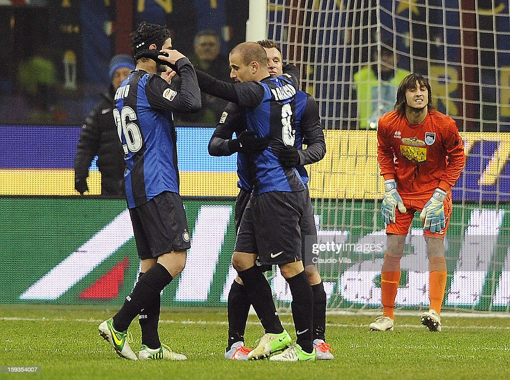 <a gi-track='captionPersonalityLinkClicked' href=/galleries/search?phrase=Rodrigo+Palacio&family=editorial&specificpeople=490993 ng-click='$event.stopPropagation()'>Rodrigo Palacio</a> of FC Inter #8 celebrates scoring the first goal during the Serie A match between FC Internazionale Milano and Pescara at San Siro Stadium on January 12, 2013 in Milan, Italy.