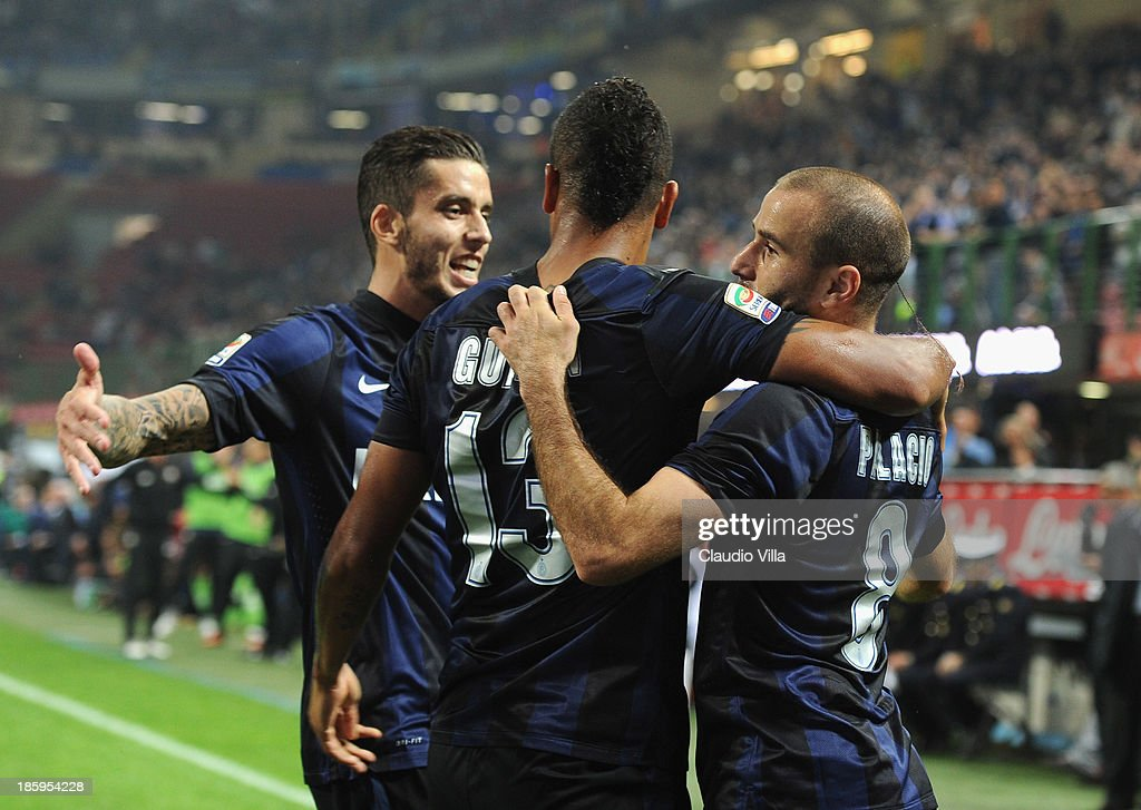 Rodrigo Palacio of FC Inter Milan (R) celebrates with team-mates after scoring their team's second goal during the Serie A match between FC Internazionale Milano and Hellas Verona at Stadio Giuseppe Meazza on October 26, 2013 in Milan, Italy.
