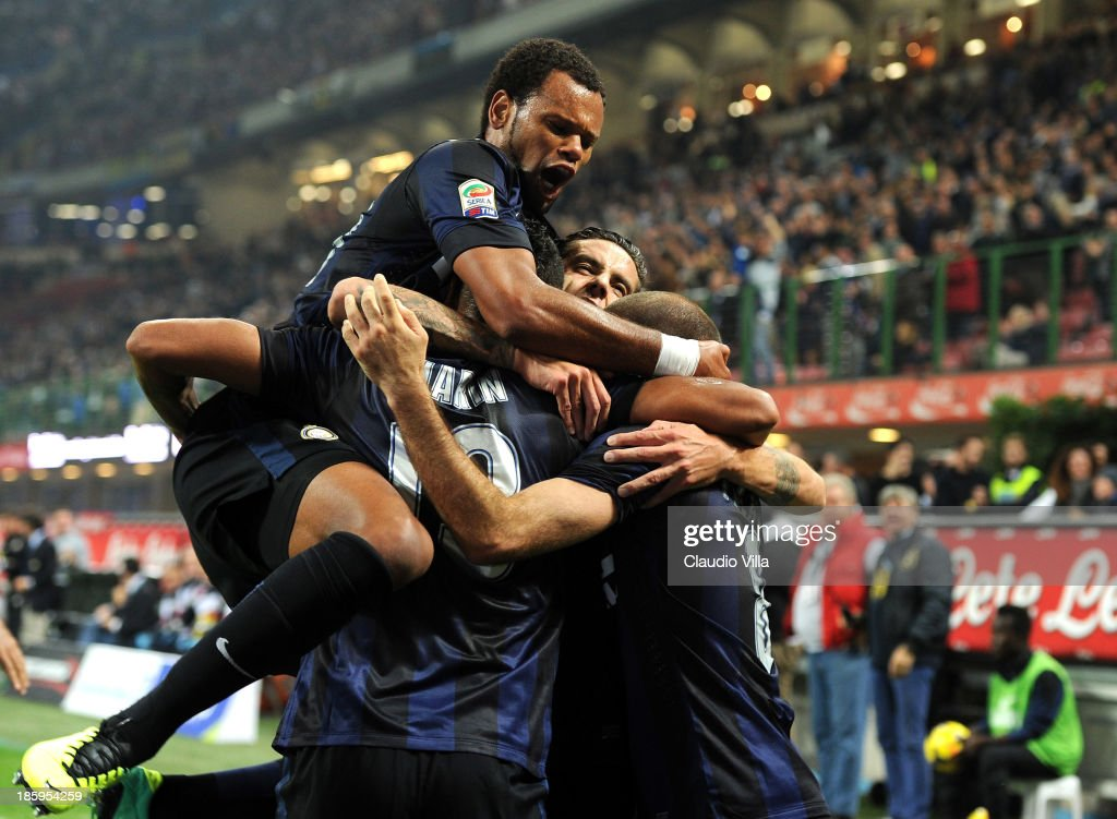 Rodrigo Palacio of FC Inter Milan is surrounded in congratulation by team-mates after scoring their team's second goal during the Serie A match between FC Internazionale Milano and Hellas Verona at Stadio Giuseppe Meazza on October 26, 2013 in Milan, Italy.