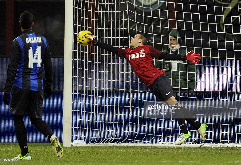 <a gi-track='captionPersonalityLinkClicked' href=/galleries/search?phrase=Rodrigo+Palacio&family=editorial&specificpeople=490993 ng-click='$event.stopPropagation()'>Rodrigo Palacio</a> of FC Inter Milan (R) saves during the TIM Cup match between FC Internazionale Milano and Hellas Verona at San Siro Stadium on December 18, 2012 in Milan, Italy.