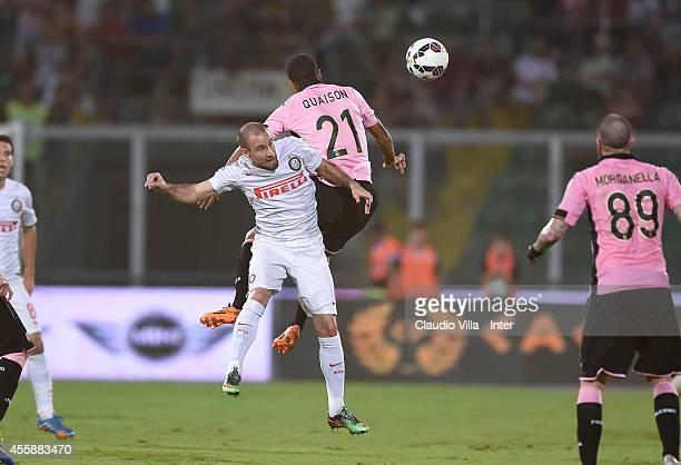 Rodrigo Palacio of FC Internazionale and Robin Quaison of US Citta di Palermo compete for the ball during the Serie A match between US Citta di...