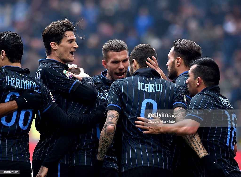 <a gi-track='captionPersonalityLinkClicked' href=/galleries/search?phrase=Rodrigo+Palacio&family=editorial&specificpeople=490993 ng-click='$event.stopPropagation()'>Rodrigo Palacio</a> (C) of FC Internazionale celebrates after scoring the first goal during the Serie A match between FC Internazionale Milano and Genoa CFC at Stadio Giuseppe Meazza on January 11, 2015 in Milan, Italy.