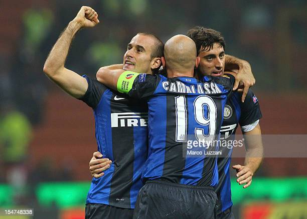Rodrigo Palacio of FC Internazionale Milano celebrates with his teammate Esteban Cambiasso and Diego Alberto Milito after scoring the opening goal...