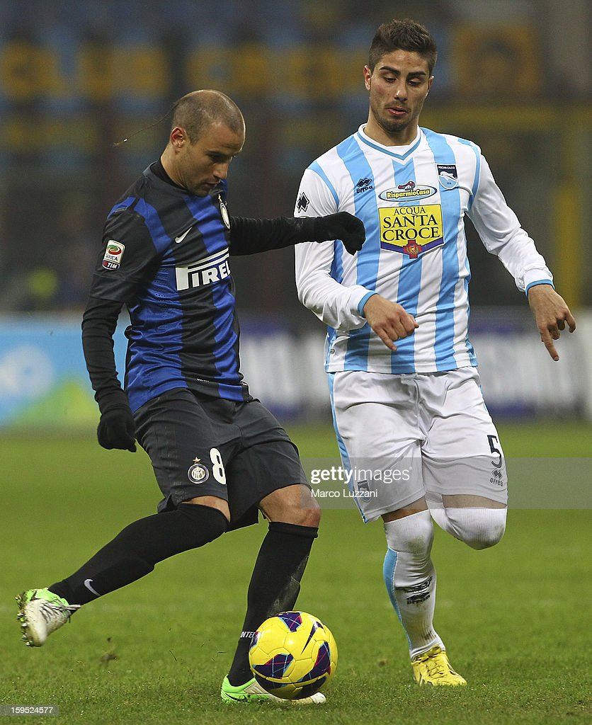 <a gi-track='captionPersonalityLinkClicked' href=/galleries/search?phrase=Rodrigo+Palacio&family=editorial&specificpeople=490993 ng-click='$event.stopPropagation()'>Rodrigo Palacio</a> (L) of FC Internazionale Milano competes for the ball with Marco Capuano of Pescara Calcio during the Serie A match between FC Internazionale Milano and Pescara at San Siro Stadium on January 12, 2013 in Milan, Italy.