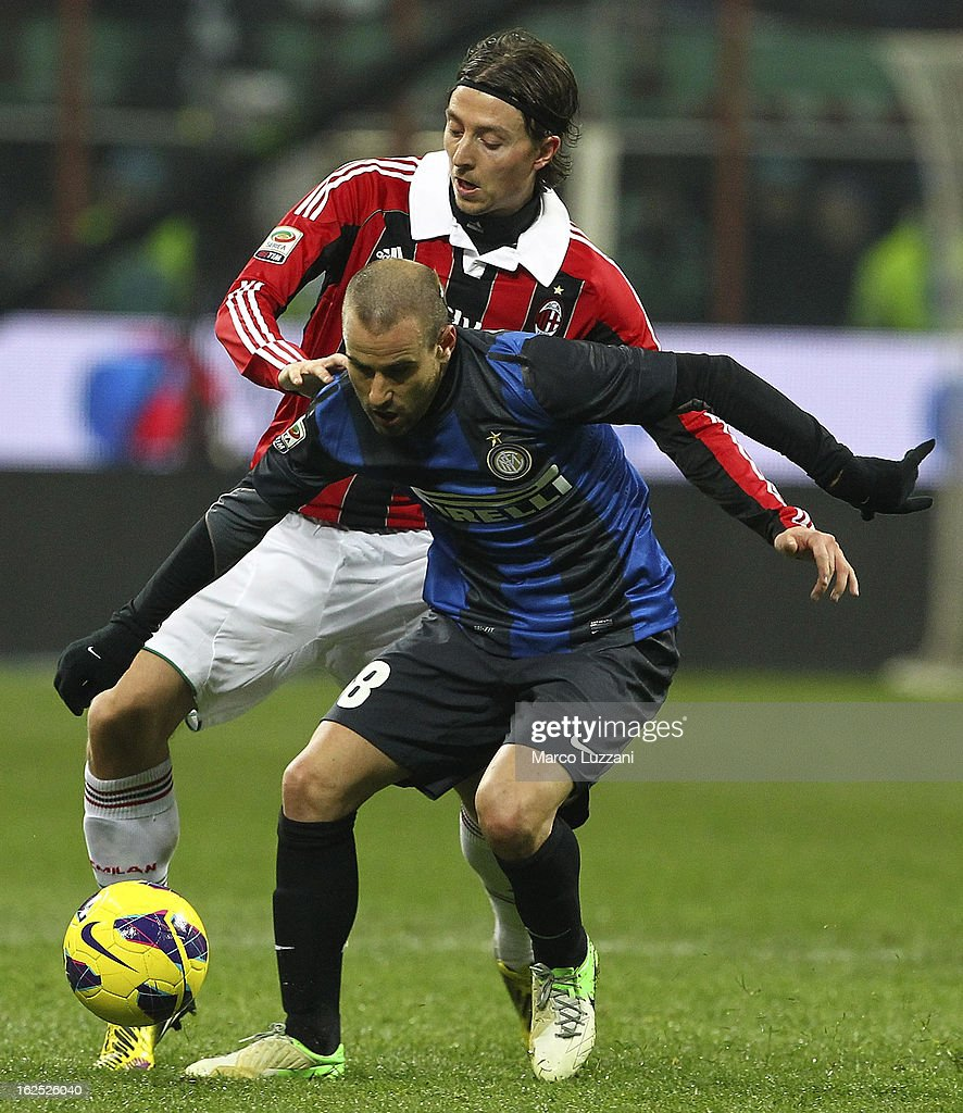 Rodrigo Palacio (R) of FC Internazionale Milano competes for the ball with Riccardo Montolivo (L) of AC Milan during the Serie A match FC Internazionale Milano and AC Milan at San Siro Stadium on February 24, 2013 in Milan, Italy.