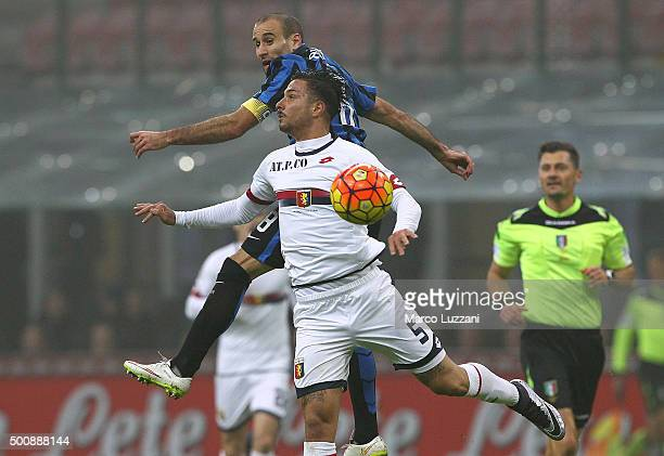 Rodrigo Palacio of FC Internazionale Milano competes for the ball with Armando Izzo of Genoa CFC during the Serie A match between FC Internazionale...