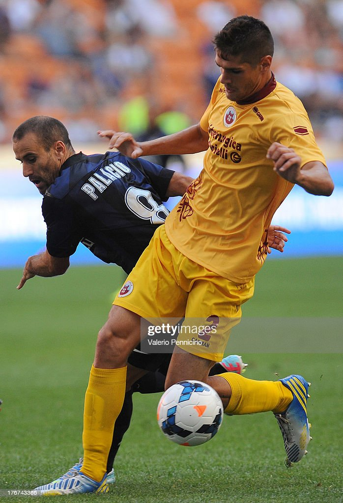 Rodrigo Palacio (L) of FC Internazionale Milano competes with Daniele Gasparetto of AS Cittadella during the TIM cup match between FC Internazionale Milano and AS Cittadella at Stadio Giuseppe Meazza on August 18, 2013 in Milan, Italy.