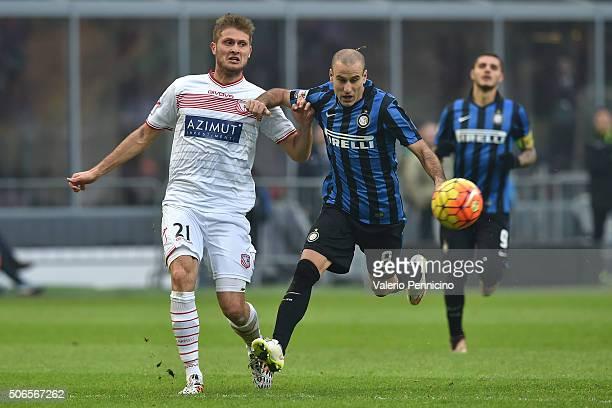 Rodrigo Palacio of FC Internazionale Milano competes with Simone Romagnoli of Carpi FC during the Serie A match between FC Internazionale Milano and...
