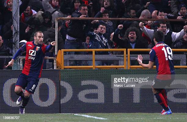 Rodrigo Palacio of Genoa CFC celebrates his second goal with teammates Cristobal Jorquera during the Serie A match between Genoa CFC and Parma FC at...