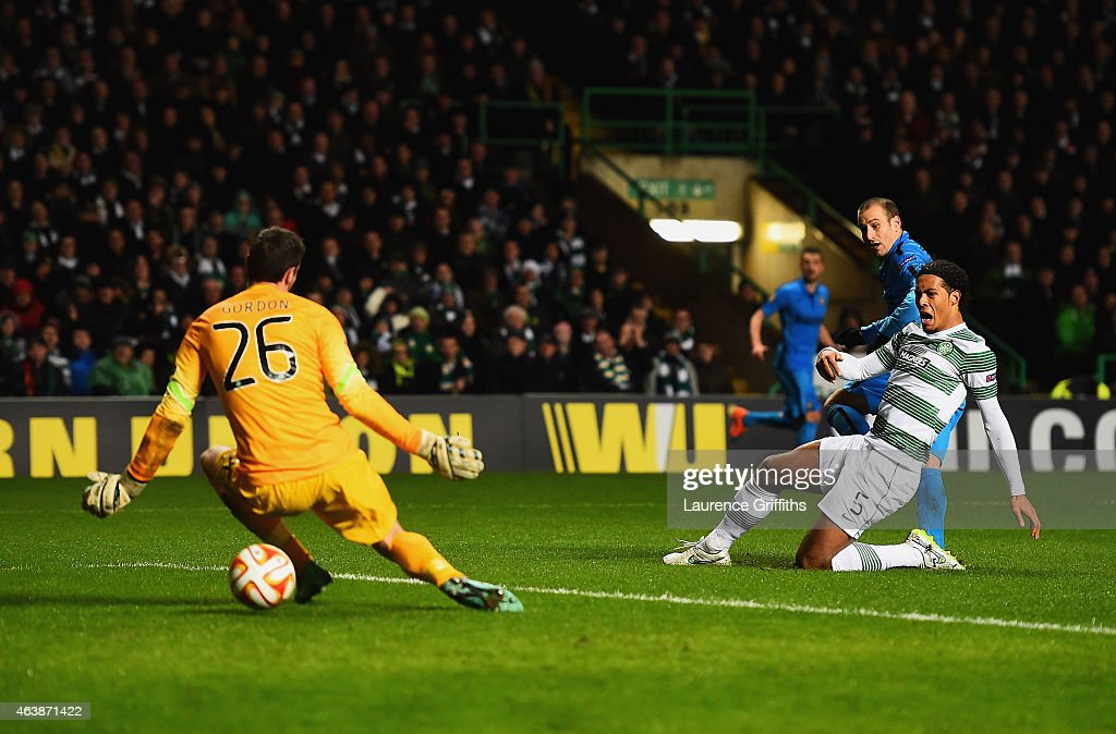 Rodrigo Palacio of Inter Milan shoots past goalkeeper Craig Gordon and Virgil van Dijk of Celtic to score their second goal during the UEFA Europa League Round of 32 match between Celtic and FC Internazionale Milano on February 19, 2015 in Glasgow, United Kingdom.