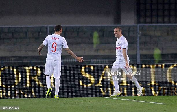 Rodrigo Palacio of Internazionale Milano celebrates with his teams mate Mauro Icardi after scoring his teams second goal during the Serie A match...