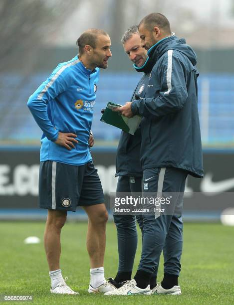 Rodrigo Palacio speaks to FC Internazionale Milano assistant coach Walter Samuel during the FC Internazionale training session at the club's training...