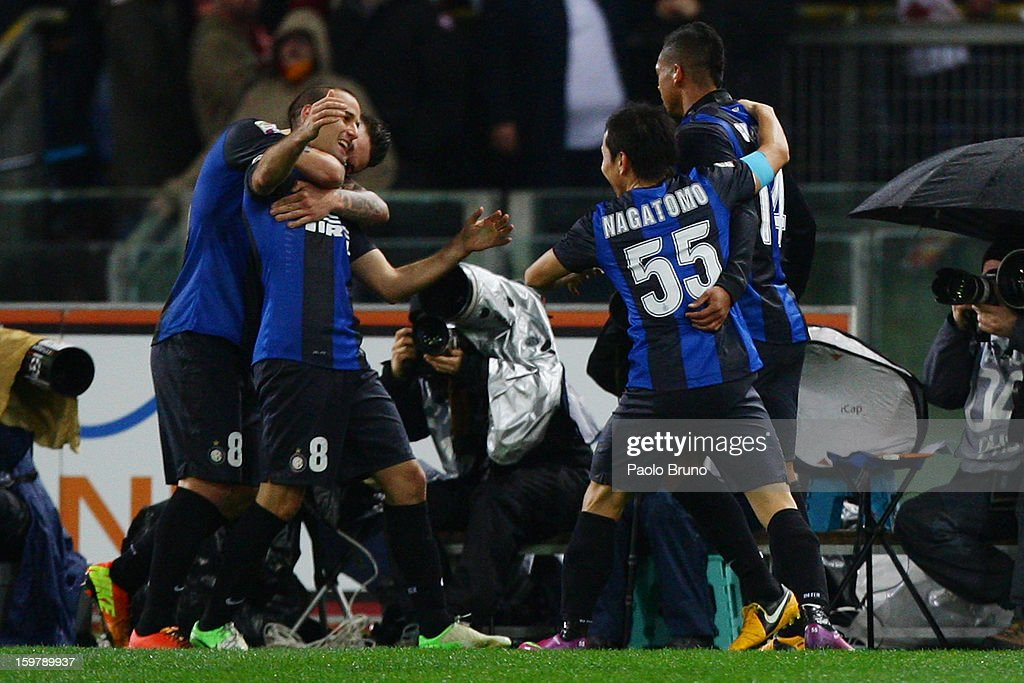<a gi-track='captionPersonalityLinkClicked' href=/galleries/search?phrase=Rodrigo+Palacio&family=editorial&specificpeople=490993 ng-click='$event.stopPropagation()'>Rodrigo Palacio</a> (2nd-L) with his teammates of FC Internazionale Milano celebrates after scoring the first team's goal during the Serie A match between AS Roma and FC Internazionale Milano at Stadio Olimpico on January 20, 2013 in Rome, Italy.