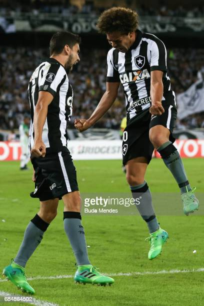 Rodrigo Pimpao and Camilo of Botafogo celebrate a scored goal against Atletico Nacional during a match between Botafogo and Atletico Nacional as part...