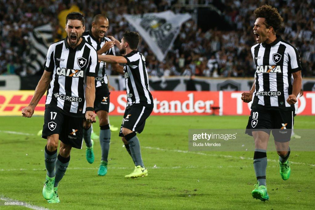 Rodrigo Pimpao (L) and Camilo of Botafogo celebrate a scored goal against Atletico Nacional during a match between Botafogo and Atletico Nacional as part of Copa Bridgestone Libertadores 2017 at Nilton Santos Olympic Stadium on May 18, 2017 in Rio de Janeiro, Brazil.