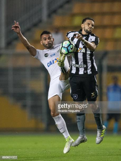 Rodrigo Pimpao of Botafogo battles for the ball with Thiago Maia of Santos during the match between Santos and Botafogo as a part of Campeonato...