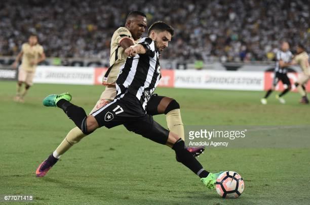 Rodrigo Pimpao of Botafogo de Futebol e Regatas in action against Pedro Pablo of Barcelona SC during Copa Libertadores of America match between...