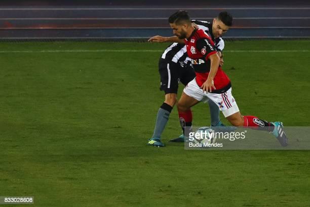 Rodrigo Pimpao of Botafogo struggles for the ball with Diego of Flamengo during a match between Botafogo and Flamengo as part of Copa do Brasil...
