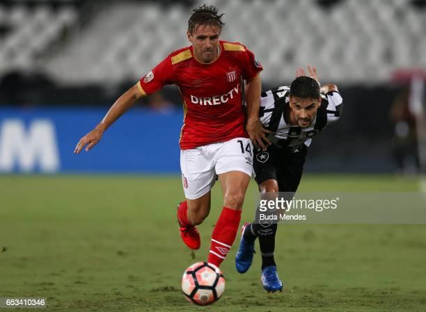 Rodrigo Pimpao of Botafogo struggles for the ball with Facundo Sanchez of Estudiantes during a match between Botafogo and Estudiantes as part of Copa...