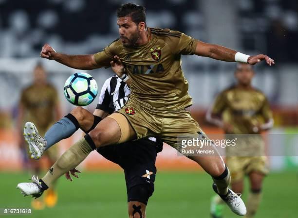 Rodrigo Pimpao of Botafogo struggles for the ball with Osvaldo Henriquez of Sport Recife during a match between Botafogo and Sport Recife as part of...