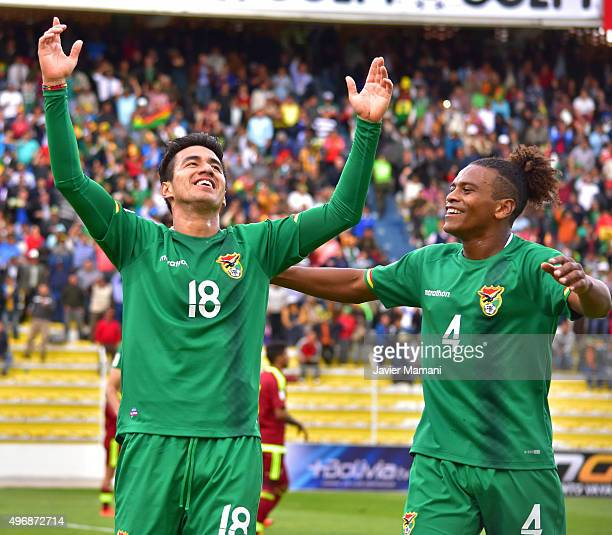 Rodrigo Ramallo of Bolivia celebrates with teammate Leonel Morales after scoring the third goal of his team during a match between Bolivia and...
