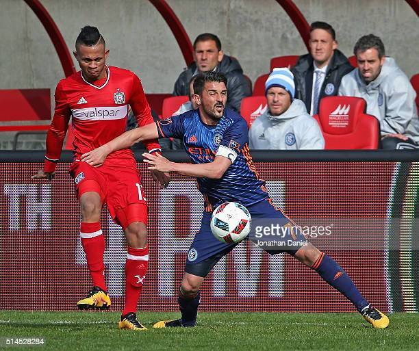Rodrigo Ramos of the Chicago Fire passes the ball around David Villa of the New York City FC at Toyota Park on March 6 2016 in Bridgeview Illinois...