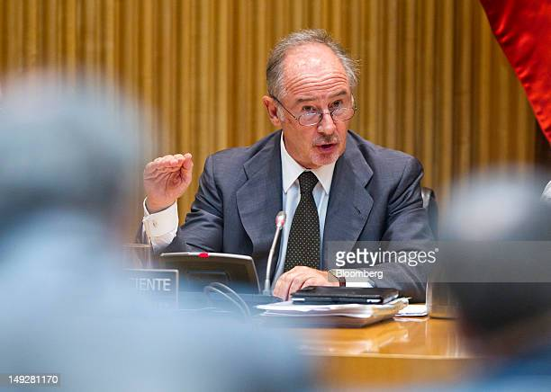 Rodrigo Rato the former chairman of Bankia SA center gestures as he speaks before a parliamentary committee in Madrid Spain on Thursday July 26 2012...