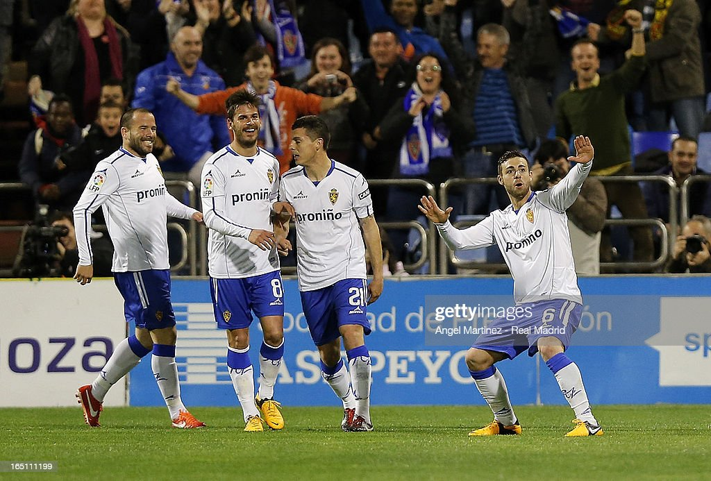 Rodrigo Rios (R) of Real Zaragoza celebrates after scoring the opening goal during the La Liga match between Real Zaragoza and Real Madrid at La Romareda on March 30, 2013 in Zaragoza, Spain.