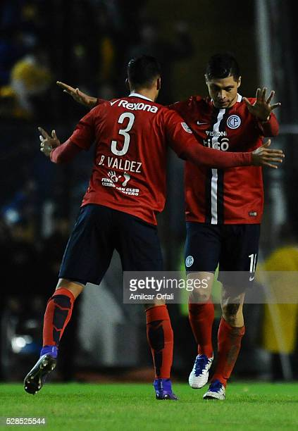 Rodrigo Rojas of Cerro Porteno celebrates with his teammate after scoring the first goal of his team during a second leg match between Boca Juniors...