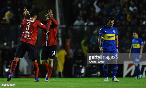 Rodrigo Rojas of Cerro Porteno celebrates with teammates after scoring the first goal of his team during a second leg match between Boca Juniors and...