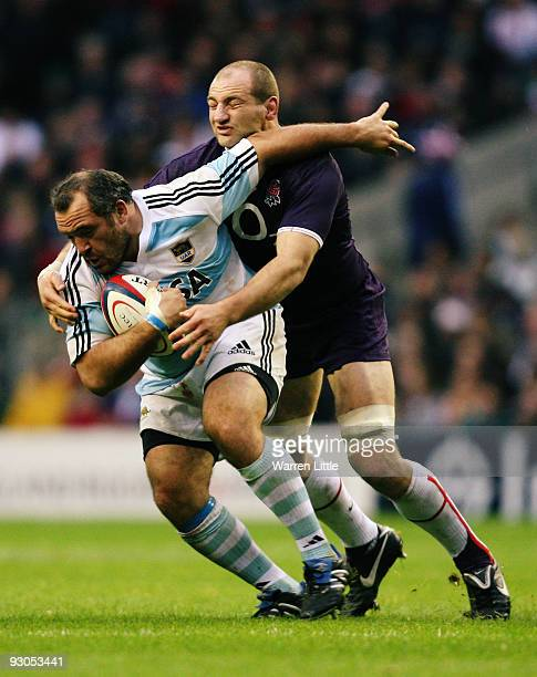 Rodrigo Roncero of Argentina is challenged by Steve Borthwick of England during the Investec Challenge match between England and Argentina at...